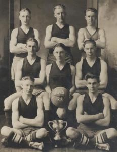 Cotton with his basketball teammates. He's back row, center.